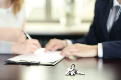 Signing of contract and keys in office